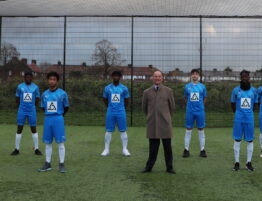 Jeremy West, Chairman and Managing Director of West and Coe Funeral Directors with the Future FC team